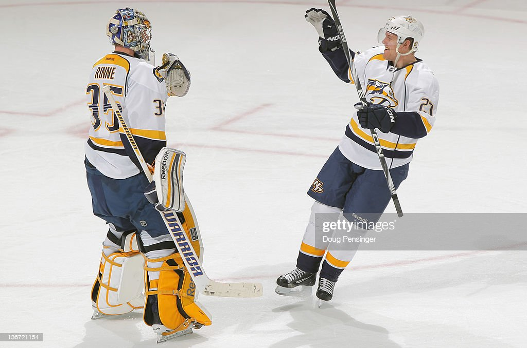 Goalie Pekka Rinne #35 and Patric Hornqvist #27 of the Nashville Predators celebrate their 4-1 victory over the Colorado Avalanche at the Pepsi Center on January 10, 2012 in Denver, Colorado.