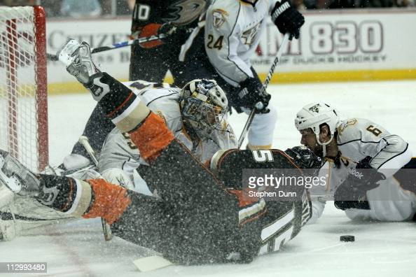 Goalie Pekka Rinne and Shea Weber of the Nashville Predators contend for the puck with Ryan Getzlaf of the Anaheim Ducks in Game Five of the Western...