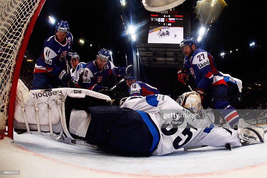 Goalie Pekka Rinne of Finland is challenged by Richard Lintner Marek Svatos Miroslav Satan and Ivan Ciernik of Slovakia during the IIHF World...