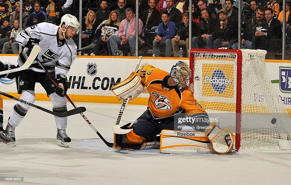 Goalie <a gi-track='captionPersonalityLinkClicked' href=/galleries/search?phrase=Pekka+Rinne&family=editorial&specificpeople=2118342 ng-click='$event.stopPropagation()'>Pekka Rinne</a> #35 of the Nashville Predators and Jake Muzzin #06 of the Los Angeles Kings watch a shot go wide of the net at the Bridgestone Arena on February 7, 2013 in Nashville, Tennessee.