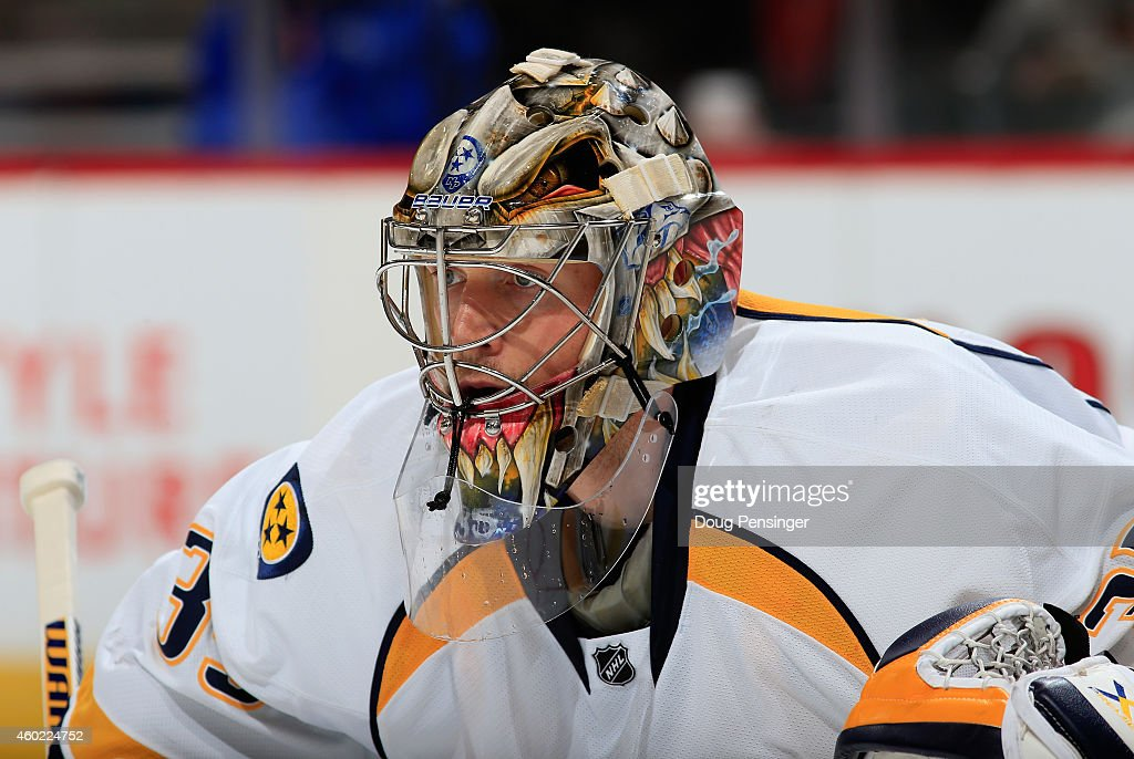 Goalie Pekka Rinne #35 of the Nashville Predators defends the goal as he had 26 saves in the Predators 3-0 victory over the Colorado Avalanche at Pepsi Center on December 9, 2014 in Denver, Colorado.