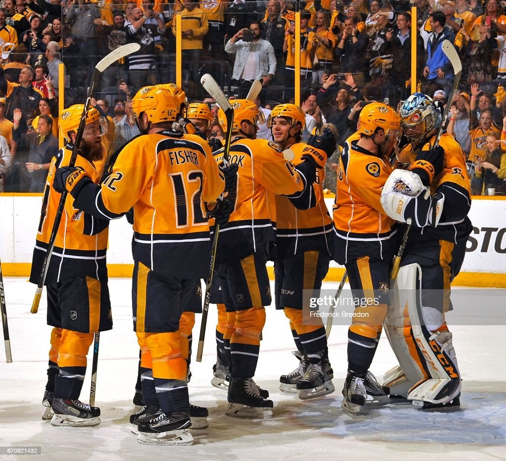 Goalie Pekka Rinne #35 of the Nashville Predators, far right, celebrates with teammates after a 4-1 victory over the Chicago Blackhawks in Game Four of the Western Conference First Round against the Chicago Blackhawks during the 2017 NHL Stanley Cup Playoffs at Bridgestone Arena on April 20, 2017 in Nashville, Tennessee.