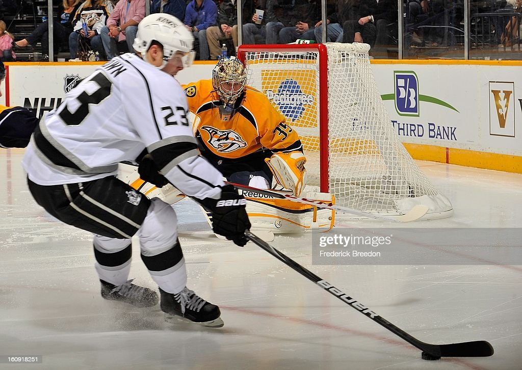 Goalie Pekka Rinne #35 of the Nashville Predators focuses on a puck being carried by Dustin Brown #23 of the Los Angeles Kings at the Bridgestone Arena on February 7, 2013 in Nashville, Tennessee.