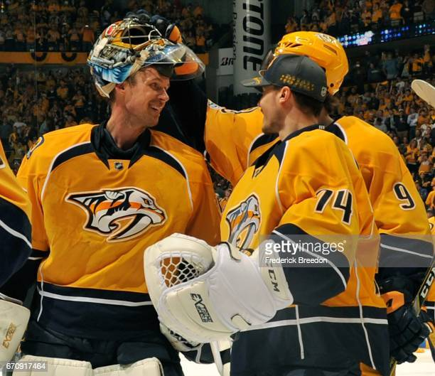 Goalie Pekka Rinne of the Nashville Predators is congratulated by teammates Juuse Saros and Filip Forsberg after a 41 victory in Game Four of the...