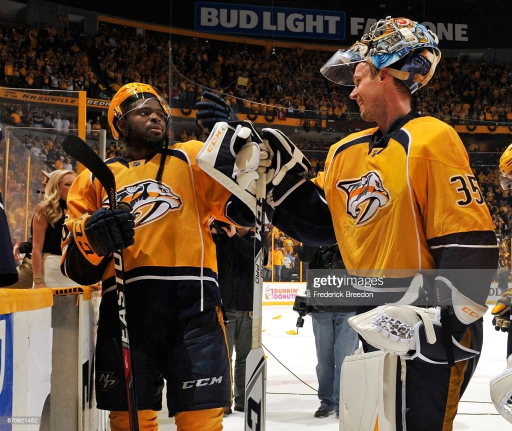 Goalie Pekka Rinne #35 of the Nashville Predators is congratulated by teammate P.K.Subban #76 after a 4-1 victory over the Chicago Blackhawks in Game Four of the Western Conference First Round during the 2017 NHL Stanley Cup Playoffs at Bridgestone Arena on April 20, 2017 in Nashville, Tennessee.