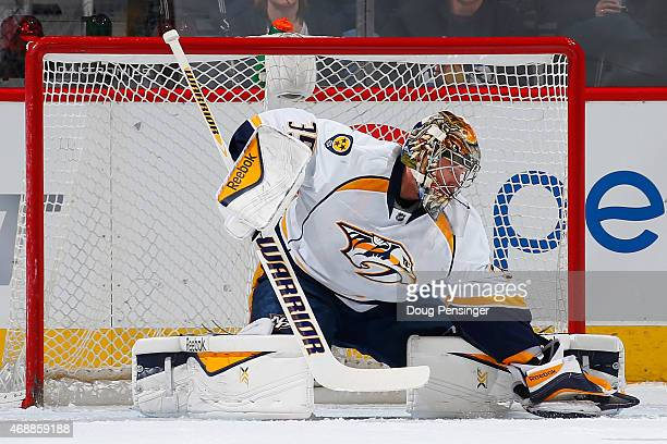Goalie Pekka Rinne of the Nashville Predators makes a glove save against the Colorado Avalanche at Pepsi Center on April 7 2015 in Denver Colorado