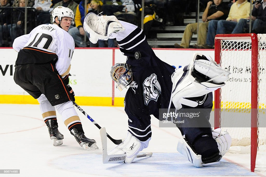 Goalie Pekka Rinne of the Nashville Predators makes a save against Corey Perry of the Anaheim Ducks on January 9 2010 at the Sommet Center in...