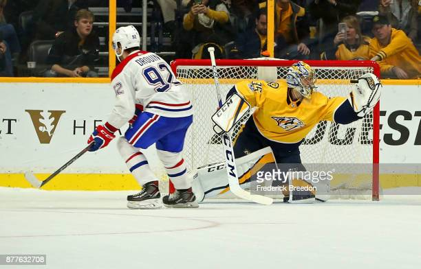 Goalie Pekka Rinne of the Nashville Predators makes a save on a shootout shot by Jonathan Drouin of the Montreal Canadiens at Bridgestone Arena on...