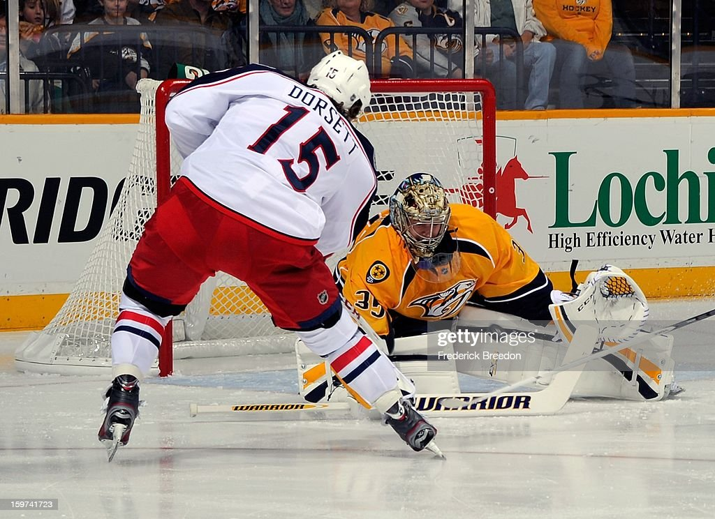 Goalie <a gi-track='captionPersonalityLinkClicked' href=/galleries/search?phrase=Pekka+Rinne&family=editorial&specificpeople=2118342 ng-click='$event.stopPropagation()'>Pekka Rinne</a> #35 of the Nashville Predators makes a save on <a gi-track='captionPersonalityLinkClicked' href=/galleries/search?phrase=Derek+Dorsett&family=editorial&specificpeople=4306277 ng-click='$event.stopPropagation()'>Derek Dorsett</a> #15 of the Columbus Blue Jackets in their season opener at Bridgestone Arena on January 19, 2013 in Nashville, Tennessee.