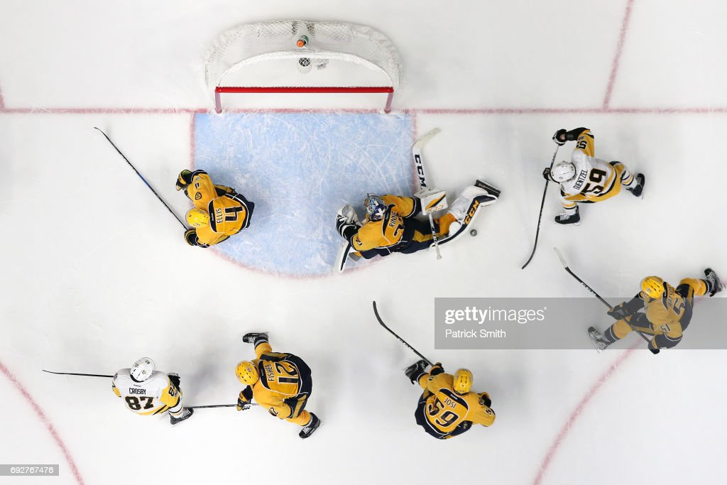 Goalie Pekka Rinne #35 of the Nashville Predators makes a save on Jake Guentzel #59 of the Pittsburgh Penguins in the third period during Game Four of the 2017 NHL Stanley Cup Final at Bridgestone Arena on June 5, 2017 in Nashville, Tennessee.