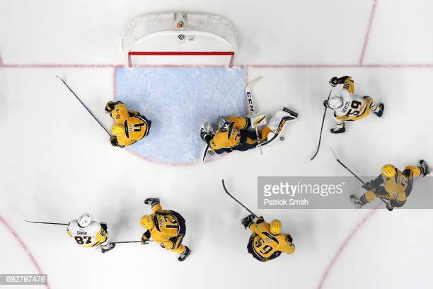 Goalie Pekka Rinne of the Nashville Predators makes a save on Jake Guentzel of the Pittsburgh Penguins in the third period during Game Four of the...