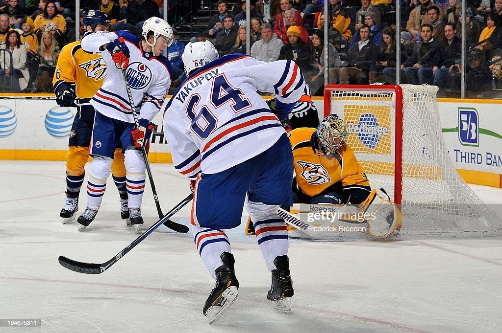 Goalie Pekka Rinne #35 of the Nashville Predators makes a save on Nail Yakupov #64 of the Edmonton Oilers at the Bridgestone Arena on March 25, 2013 in Nashville, Tennessee.