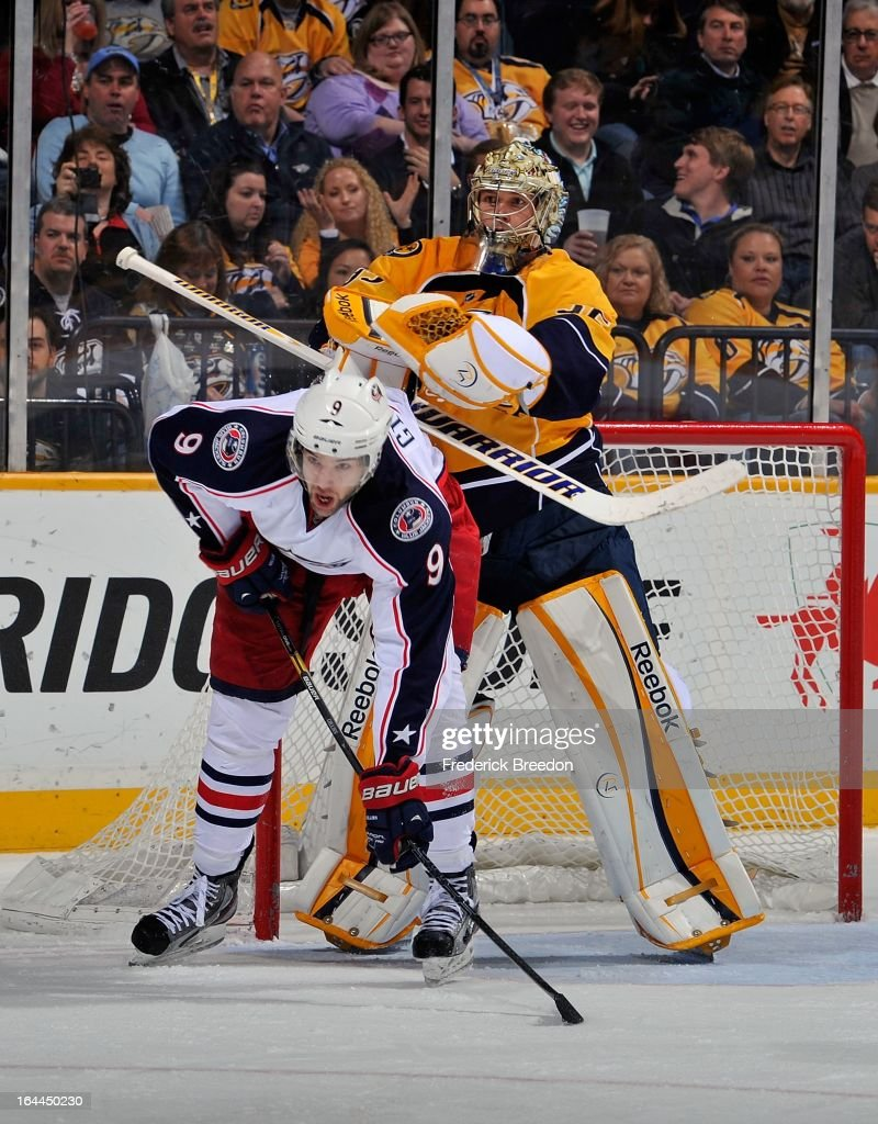 Goalie <a gi-track='captionPersonalityLinkClicked' href=/galleries/search?phrase=Pekka+Rinne&family=editorial&specificpeople=2118342 ng-click='$event.stopPropagation()'>Pekka Rinne</a> #35 of the Nashville Predators tries to clear <a gi-track='captionPersonalityLinkClicked' href=/galleries/search?phrase=Colton+Gillies&family=editorial&specificpeople=4111551 ng-click='$event.stopPropagation()'>Colton Gillies</a> #9 of the Columbus Blue Jackets out of the crease at the Bridgestone Arena on March 23, 2013 in Nashville, Tennessee.