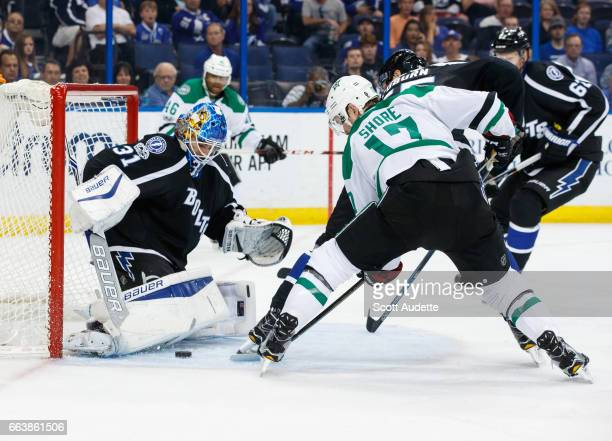 Goalie Peter Budaj of the Tampa Bay Lightning makes a save against Devin Shore of the Dallas Stars during second period at Amalie Arena on April 2...