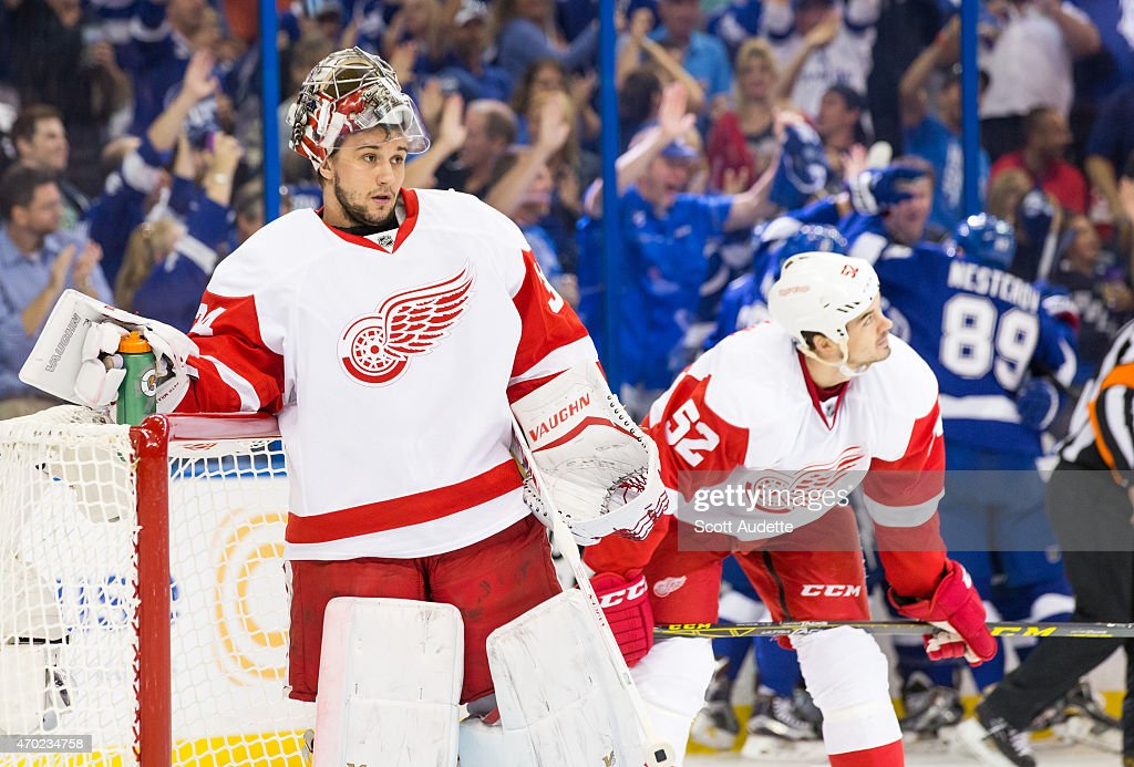 Goalie <a gi-track='captionPersonalityLinkClicked' href=/galleries/search?phrase=Petr+Mrazek&family=editorial&specificpeople=6514148 ng-click='$event.stopPropagation()'>Petr Mrazek</a> #34 and <a gi-track='captionPersonalityLinkClicked' href=/galleries/search?phrase=Jonathan+Ericsson&family=editorial&specificpeople=2538498 ng-click='$event.stopPropagation()'>Jonathan Ericsson</a> #52 react to a goal against them by the Tampa Bay Lightning during the first period in Game Two of the Eastern Conference Quarterfinals during the 2015 NHL Stanley Cup Playoffs at the Amalie Arena on April 18, 2015 in Tampa, Florida.