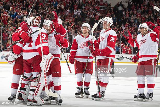 Goalie Petr Mrazek of the Detroit Red Wings is congratulated by teammates following a shootout win of an NHL game against the Boston Bruins at Joe...