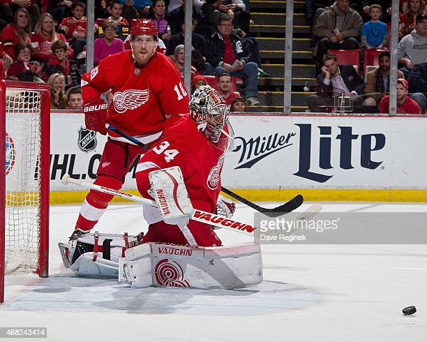 Goalie Petr Mrazek of the Detroit Red Wings looks to make a save while teammate Joakim Andersson follows the play during a NHL game against the...