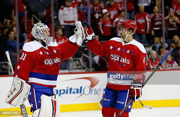Goalie Philipp Grubauer and Justin Williams of the Washington Capitals celebrate following the Capitals 52 win over the New York Rangers at Verizon...