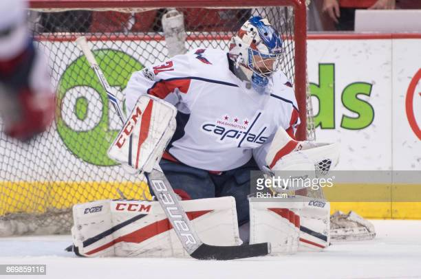 Goalie Philipp Grubauer of the Washington Capitals makes a save prior to NHL action against the Vancouver Canucks on October 2017 at Rogers Arena in...