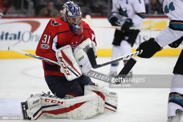 Goalie Philipp Grubauer of the Washington Capitals makes a save against the San Jose Sharks during the first period at Capital One Arena on December...