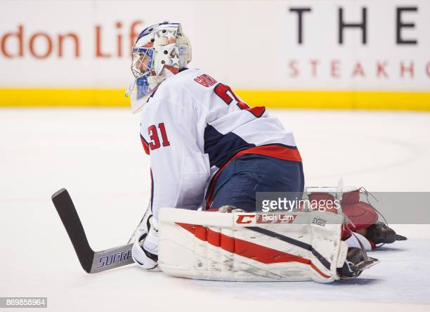 Goalie Philipp Grubauer of the Washington Capitals stretches during a break in NHL action against the Vancouver Canucks on October 2017 at Rogers...