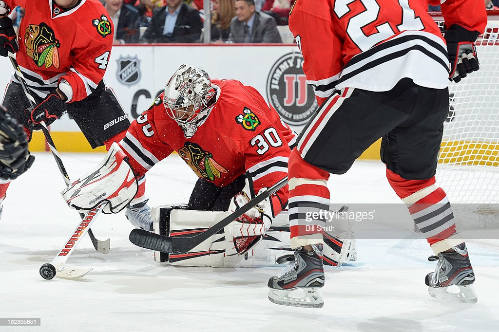 Goalie <a gi-track='captionPersonalityLinkClicked' href=/galleries/search?phrase=Ray+Emery&family=editorial&specificpeople=218109 ng-click='$event.stopPropagation()'>Ray Emery</a> #30 of the Chicago Blackhawks makes a stop during the NHL game against the San Jose Sharks on February 22, 2013 at the United Center in Chicago, Illinois.