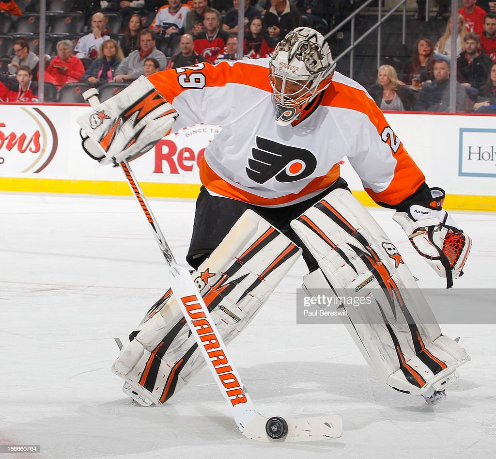 Goalie <a gi-track='captionPersonalityLinkClicked' href=/galleries/search?phrase=Ray+Emery&family=editorial&specificpeople=218109 ng-click='$event.stopPropagation()'>Ray Emery</a> #29 of the Philadelphia Flyers controls the puck in the second period of an NHL hockey game against the New Jersey Devils as Emery got the shutout in the 1-0 Flyers win at Prudential Center on November 2, 2013 in Newark, New Jersey.