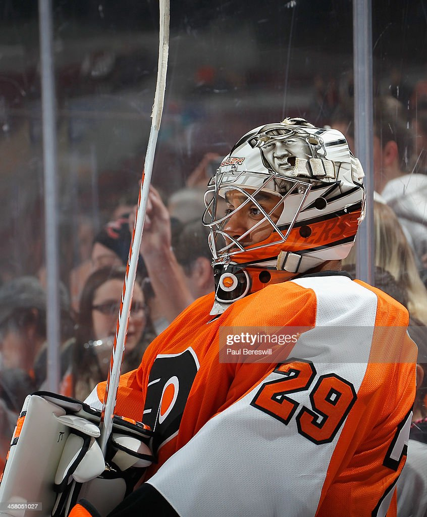 Goalie Ray Emery #29 of the Philadelphia Flyers leans against the glass during warmups before an NHL hockey game against the Washington Capitals at Wells Fargo Center on December 17, 2013 in Philadelphia, Pennsylvania.