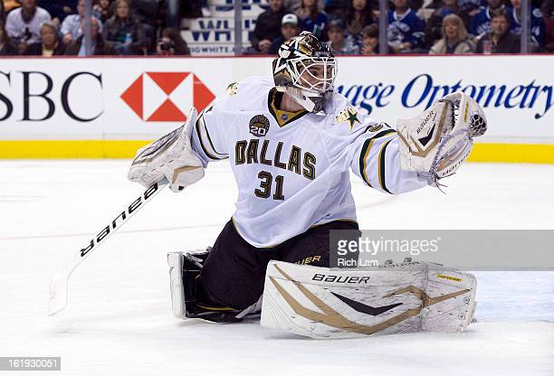 Goalie Richard Bachman of the Dallas Stars makes a glove save during NHL action against the Vancouver Canucks on February 15 2013 at Rogers Arena in...