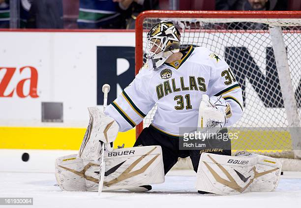 Goalie Richard Bachman of the Dallas Stars makes a save during the pregame warm up prior to NHL action against the Vancouver Canucks on February 15...