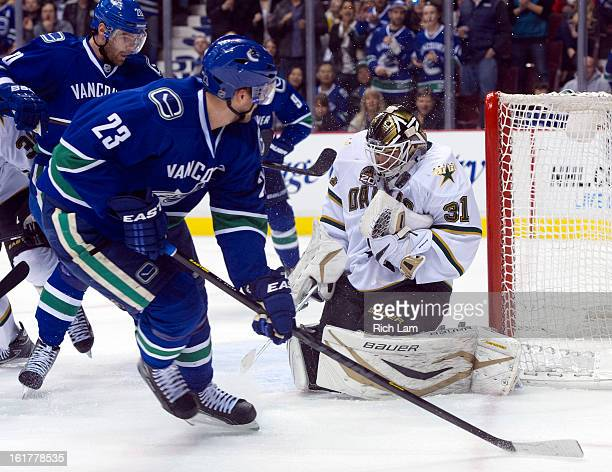 Goalie Richard Bachman of the Dallas Stars stops a shot by Alexander Edler of the Vancouver Canucks in close during the second period in NHL action...