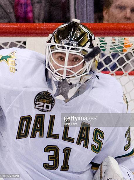 Goalie Richard Bachman of the Dallas Stars watches the puck on a save against the Vancouver Canucks during the third period in NHL action on February...