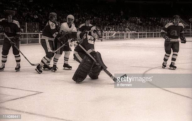 Goalie Richard Brodeur and Francois Lacombe of the Quebec Nordiques defend the net during their game against the Minnesota Fighting Saints on April 2...