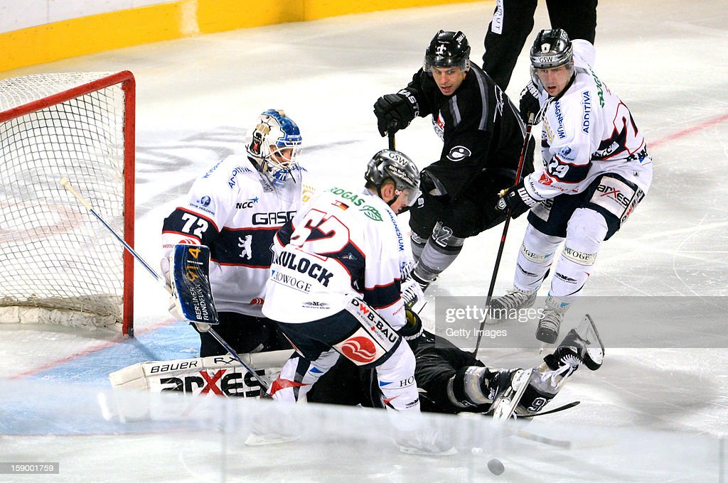 Goalie <a gi-track='captionPersonalityLinkClicked' href=/galleries/search?phrase=Rob+Zepp&family=editorial&specificpeople=3121630 ng-click='$event.stopPropagation()'>Rob Zepp</a> (L), T. J. Mulock of Berlin (2nd L) of Berlin and <a gi-track='captionPersonalityLinkClicked' href=/galleries/search?phrase=Jens+Baxmann&family=editorial&specificpeople=2113047 ng-click='$event.stopPropagation()'>Jens Baxmann</a> of Berlin (R) are challenged by Yasin Ehliz (M) of Nuremberg and <a gi-track='captionPersonalityLinkClicked' href=/galleries/search?phrase=Eric+Chouinard&family=editorial&specificpeople=204685 ng-click='$event.stopPropagation()'>Eric Chouinard</a> (hidden) of Nuremberg during the DEL Winter Game 2013 at Stadion Nuernberg on January 5, 2013 in Nuremberg, Germany.