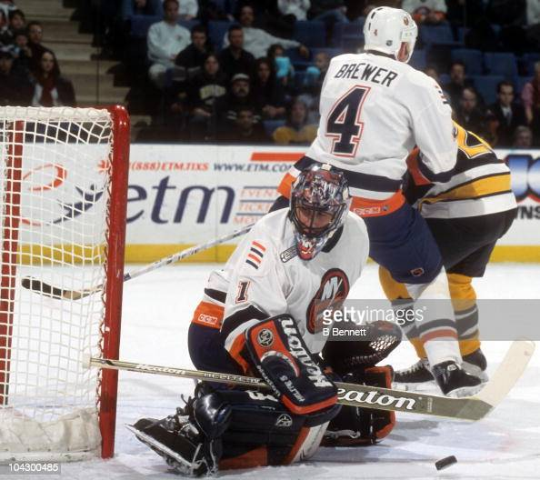 Goalie Roberto Luongo of the New York Islanders makes the save as teammate Eric Brewer blocks out a player for the Boston Bruins on December 27 1999...