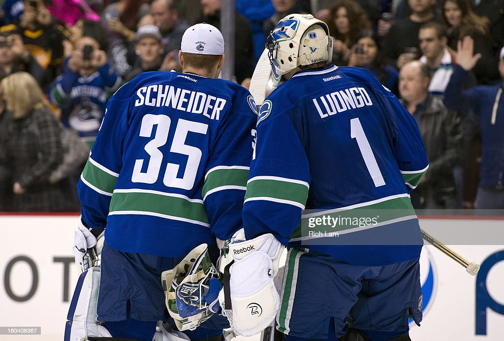 Goalie <a gi-track='captionPersonalityLinkClicked' href=/galleries/search?phrase=Roberto+Luongo&family=editorial&specificpeople=202638 ng-click='$event.stopPropagation()'>Roberto Luongo</a> #1 of the Vancouver Canucks and <a gi-track='captionPersonalityLinkClicked' href=/galleries/search?phrase=Cory+Schneider&family=editorial&specificpeople=696908 ng-click='$event.stopPropagation()'>Cory Schneider</a> #35 skate off the ice after defeating the Colorado Avalanche 3-0 in NHL action on January 30, 2013 at Rogers Arena in Vancouver, British Columbia, Canada.