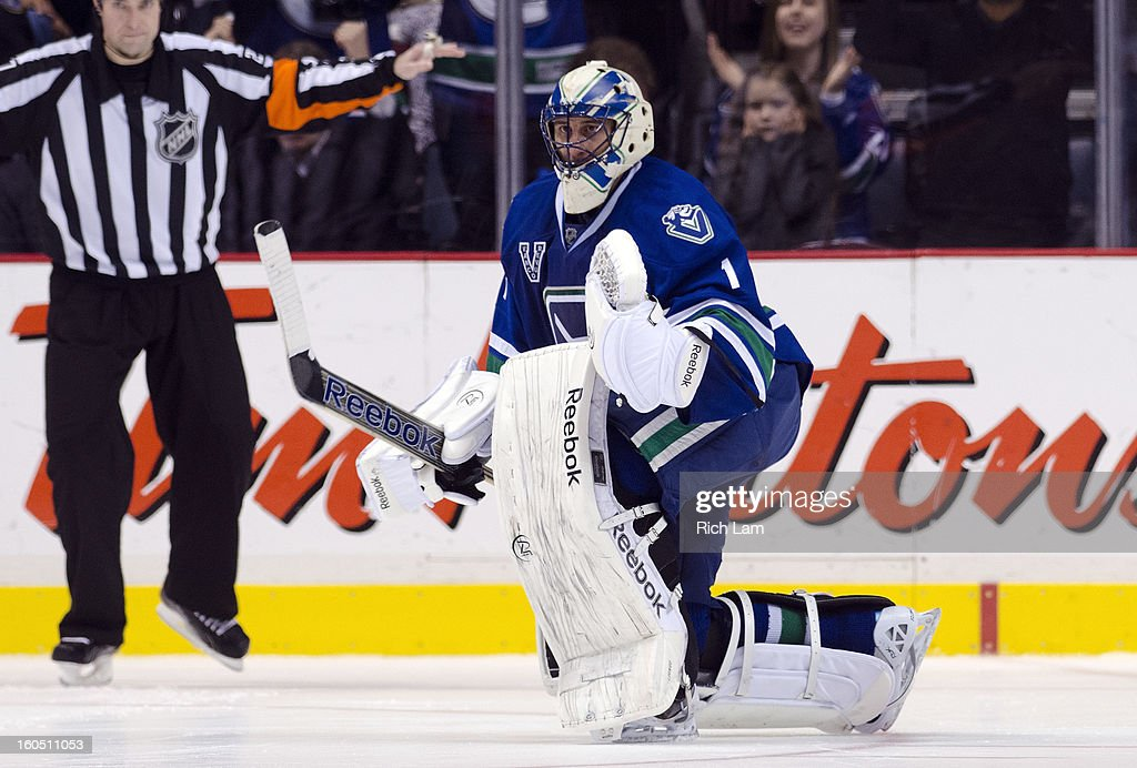 Goalie <a gi-track='captionPersonalityLinkClicked' href=/galleries/search?phrase=Roberto+Luongo&family=editorial&specificpeople=202638 ng-click='$event.stopPropagation()'>Roberto Luongo</a> #1 of the Vancouver Canucks celebrates after defeating the Chicago Blackhawks 2-1 in a shootout during NHL action on February 1, 2013 at Rogers Arena in Vancouver, British Columbia, Canada.