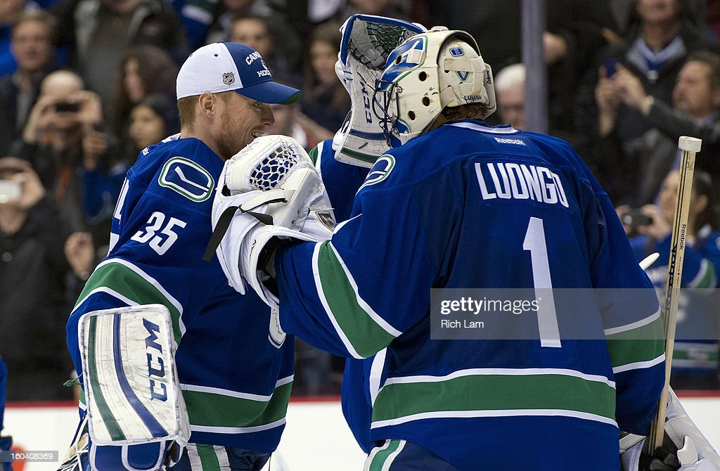 Goalie Roberto Luongo #1 of the Vancouver Canucks is congratulated by teammate Cory Schneider #35 of the Vancouver Canucks after defeating the Colorado Avalanche 3-0 in NHL action on January 30, 2013 at Rogers Arena in Vancouver, British Columbia, Canada.