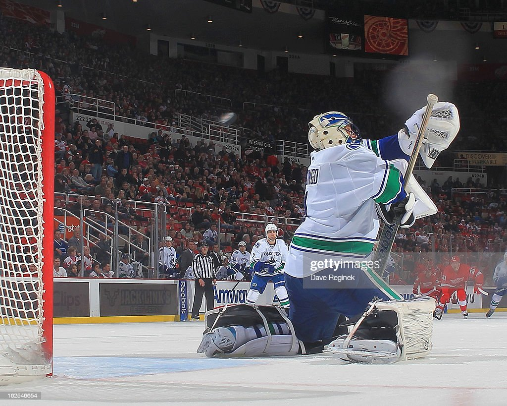 Goalie <a gi-track='captionPersonalityLinkClicked' href=/galleries/search?phrase=Roberto+Luongo&family=editorial&specificpeople=202638 ng-click='$event.stopPropagation()'>Roberto Luongo</a> #1 of the Vancouver Canucks is scored on in the third period by Joakin Anderson #63 (not pictured) of the Detroit Red Wings during a NHL game at Joe Louis Arena on February 24, 2013 in Detroit, Michigan. The Wings won 8-3