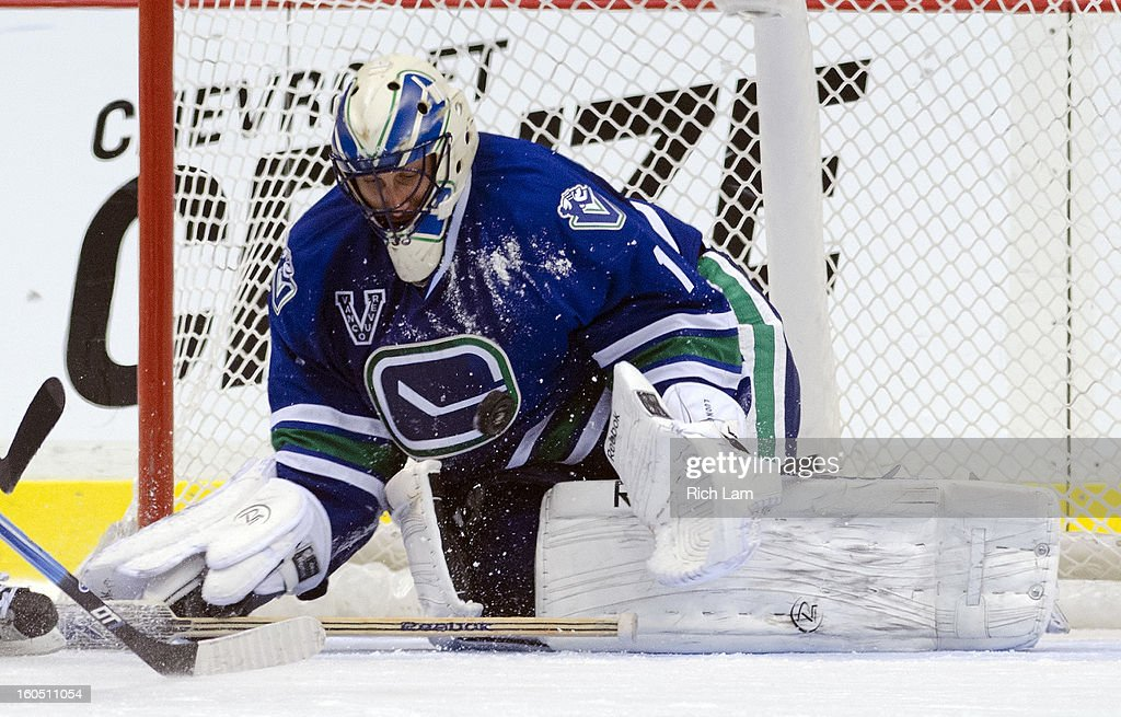 Goalie <a gi-track='captionPersonalityLinkClicked' href=/galleries/search?phrase=Roberto+Luongo&family=editorial&specificpeople=202638 ng-click='$event.stopPropagation()'>Roberto Luongo</a> #1 of the Vancouver Canucks makes a save against the Chicago Blackhawks during the third period in NHL action on February 1, 2013 at Rogers Arena in Vancouver, British Columbia, Canada.
