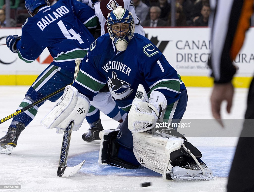 Goalie <a gi-track='captionPersonalityLinkClicked' href=/galleries/search?phrase=Roberto+Luongo&family=editorial&specificpeople=202638 ng-click='$event.stopPropagation()'>Roberto Luongo</a> #1 of the Vancouver Canucks makes a save during the third period in NHL action against the Colorado Avalanche on January 30, 2013 at Rogers Arena in Vancouver, British Columbia, Canada.