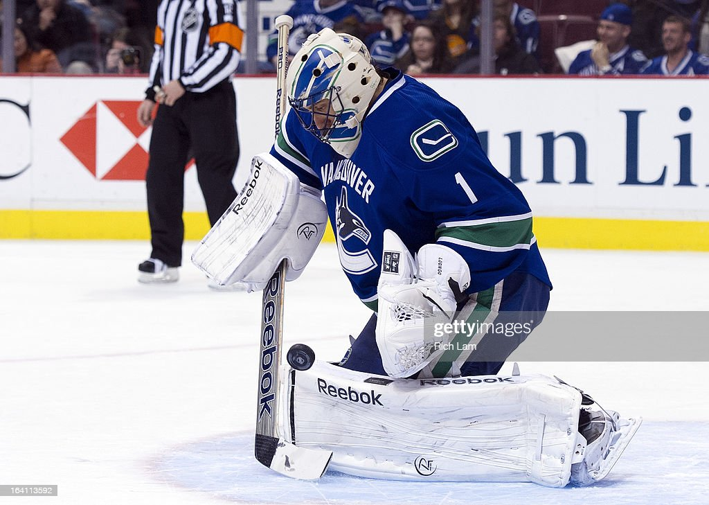 Goalie Roberto Luongo #1 of the Vancouver Canucks makes a save during NHL action against the Minnesota Wild on March 18, 2013 at Rogers Arena in Vancouver, British Columbia, Canada.