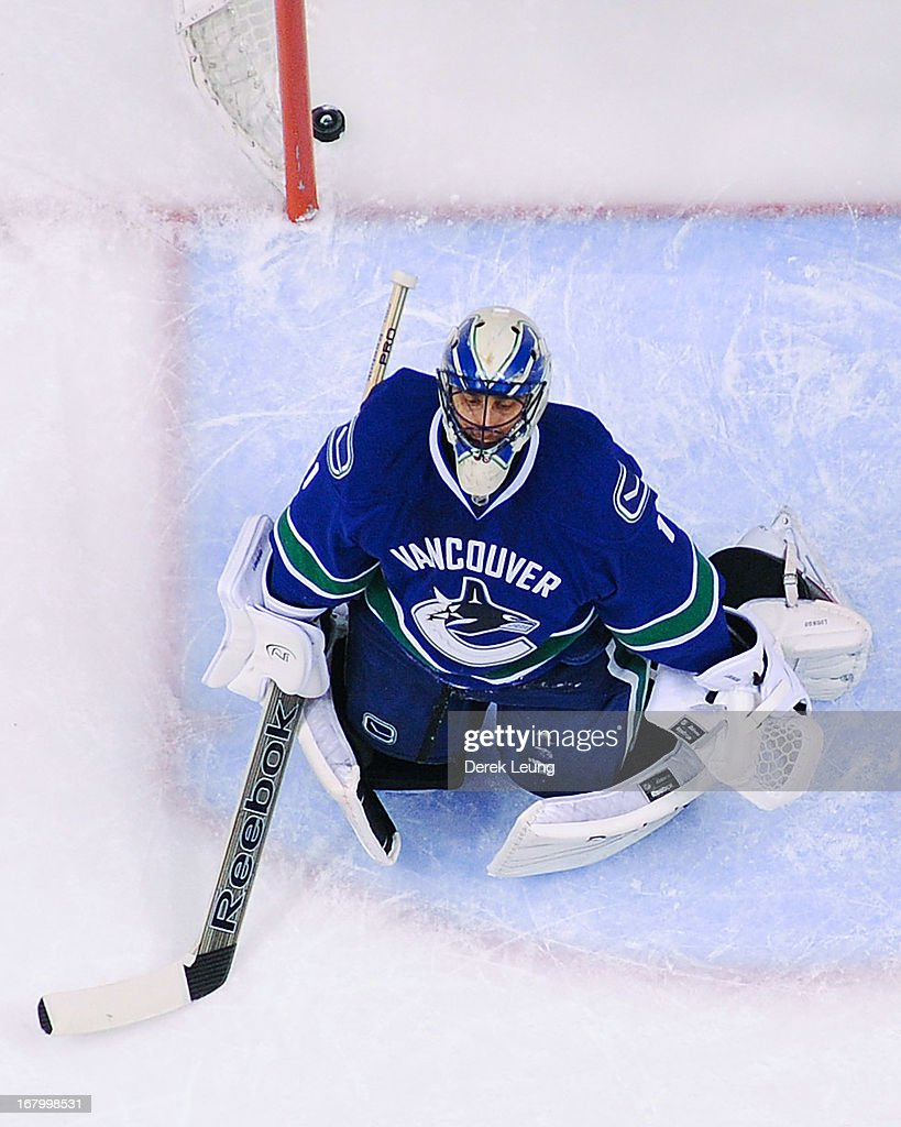 Goalie <a gi-track='captionPersonalityLinkClicked' href=/galleries/search?phrase=Roberto+Luongo&family=editorial&specificpeople=202638 ng-click='$event.stopPropagation()'>Roberto Luongo</a> #1 of the Vancouver Canucks sits in his crease after Raffi Torres (not pictured) of the San Jose Sharks scored the game-winning goal in Game Two of the Western Conference Quarterfinals during the 2013 NHL Stanley Cup Playoffs at Rogers Arena on May 3, 2013 in Vancouver, British Columbia, Canada.