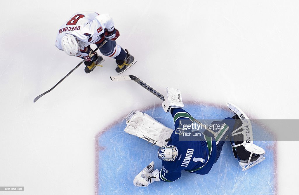 Goalie <a gi-track='captionPersonalityLinkClicked' href=/galleries/search?phrase=Roberto+Luongo&family=editorial&specificpeople=202638 ng-click='$event.stopPropagation()'>Roberto Luongo</a> #1 of the Vancouver Canucks stops Alex Ovechkin #8 of the Washington Capitals on a penalty shot during the first period in NHL action on October 28, 2013 at Rogers Arena in Vancouver, British Columbia, Canada.