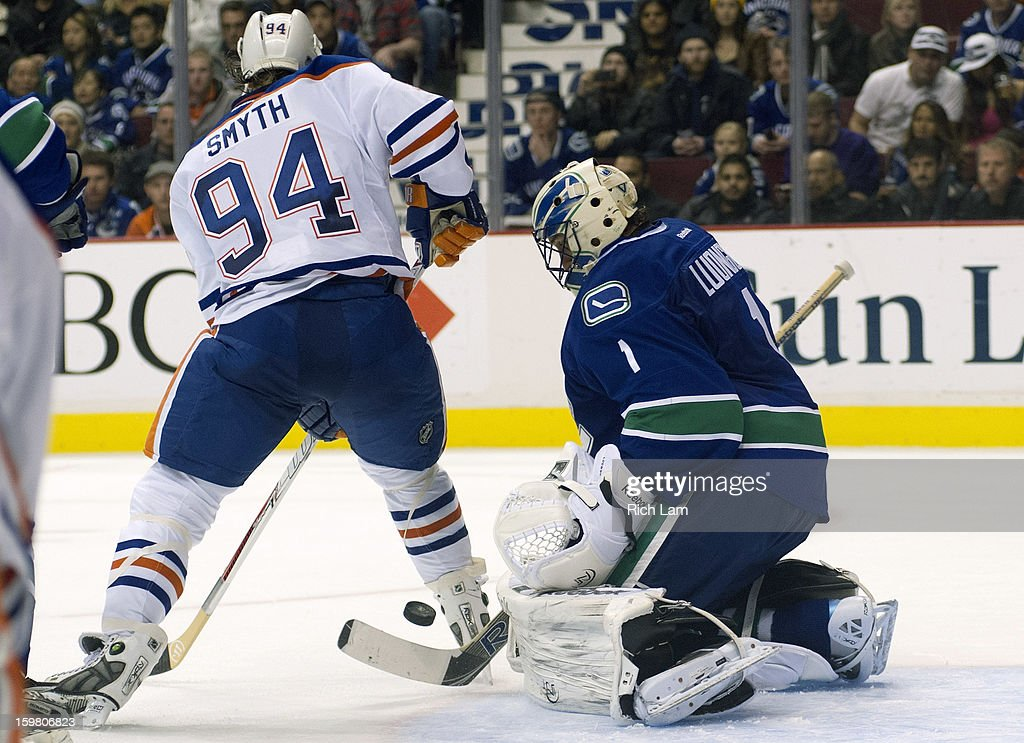 Goalie Roberto Luongo #1 of the Vancouver Canucks stops Ryan Smyth #94 of the Edmonton Oilers in close during the third period of NHL action on January 20, 2013 at Rogers Arena in Vancouver, British Columbia, Canada.