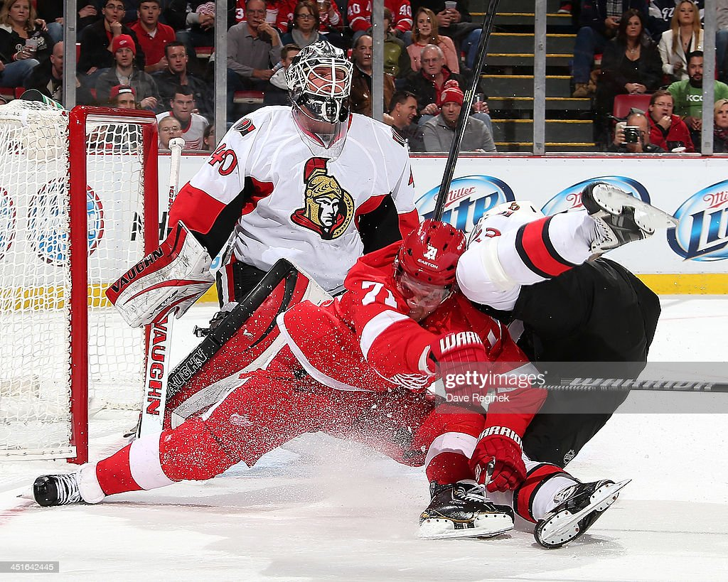 Goalie <a gi-track='captionPersonalityLinkClicked' href=/galleries/search?phrase=Robin+Lehner&family=editorial&specificpeople=5894610 ng-click='$event.stopPropagation()'>Robin Lehner</a> #40 of the Ottawa Senators looks over teammate <a gi-track='captionPersonalityLinkClicked' href=/galleries/search?phrase=Mika+Zibanejad&family=editorial&specificpeople=7832310 ng-click='$event.stopPropagation()'>Mika Zibanejad</a> #93 as he goes to the ice with <a gi-track='captionPersonalityLinkClicked' href=/galleries/search?phrase=Daniel+Cleary&family=editorial&specificpeople=220490 ng-click='$event.stopPropagation()'>Daniel Cleary</a> #71 of the Detroit Red Wings during an NHL game at Joe Louis Arena on November 23, 2013 in Detroit, Michigan. Ottawa defeated Detroit 4-2