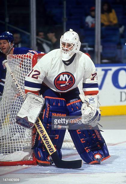 Goalie Ron Hextall of the New York Islanders defends the net during an NHL game against the New York Rangers circa 1994 at the Nassau Coliseum in...