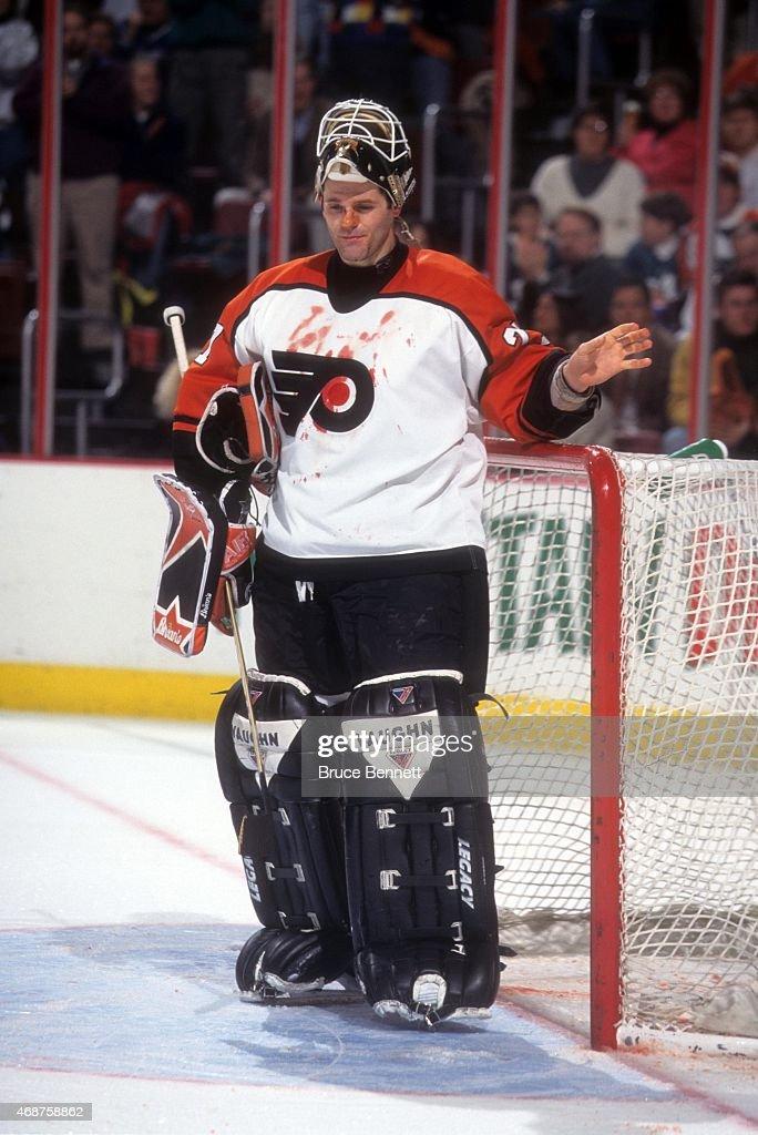 ... Goalie Ron Hextall 29 of the Philadelphia Flyers goes for his Gatorade  bottle as his ... 50779f077c7