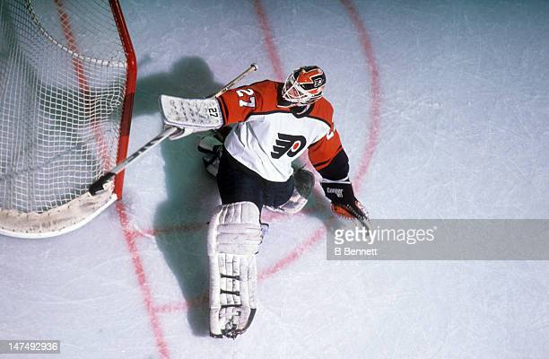 Goalie Ron Hextall of the Philadelphia Flyers makes the save during an NHL game circa 1995 at the Spectrum in Philadelphia Pennsylvania