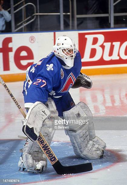 Goalie Ron Hextall of the Quebec Nordiques defends the net during an NHL game circa 1993